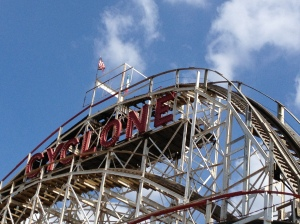 The Cyclone towers over the Coney Island boardwalk in Brooklyn at the corner of Surf and Stillwell.