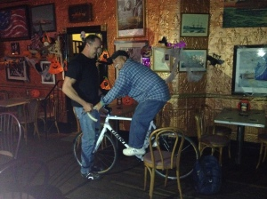 Joe tries on Jimmy's bike for size at Liedy's Shore Inn on Staten Island.