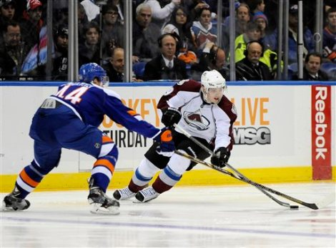 Colorado Avalanche's Matt Duchene, right, controls the puck against New York Islanders' Calvin de Haan (44) in the third period of an NHL hockey game on Saturday, Feb. 8, 2014, in Uniondale, N.Y. Duchene scored two goals during the Avalanche's 5-2 win. (AP Photo/Kathy Kmonicek)