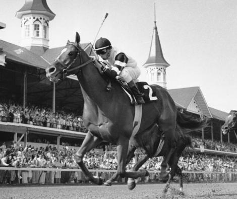 Affirmed, shown here winning the Kentucky Derby, was the last horse to capture the Triple Crown. (AP Photo)