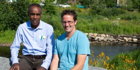 Mill River Collaborative Executive Director Milton Puryear, left, and Alex Domeyko, program and outreach manager, in front of the Rippowam River. (Photo: Leif Skodnick